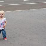 Little Girl on Sidewalk